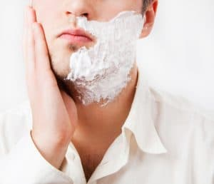 Young man with foam shaving his beard @kozirsky
